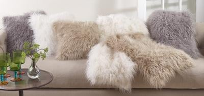 fur pillows on couch